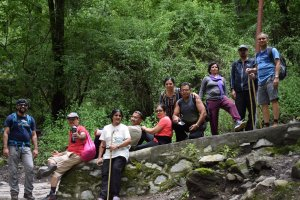 Utttarakhand Trip Trek:  some-trekker-resting-on-the-way-to-ghangaria-valley-of-flower-trek