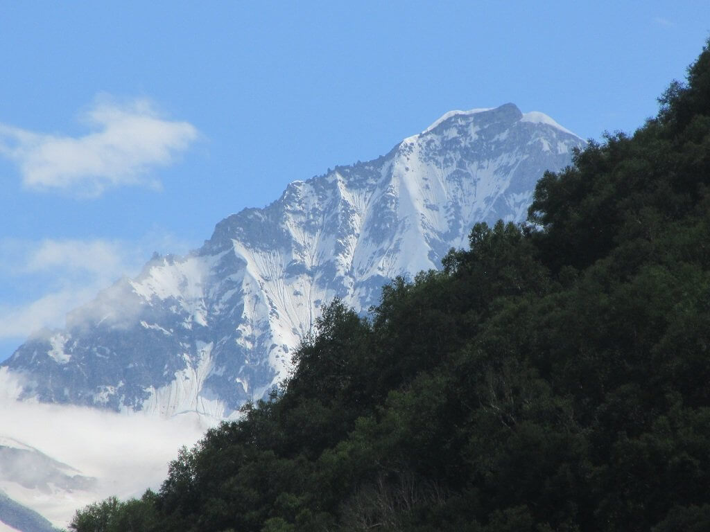 Snow covered mountain from valley of flower trek, uttarakhand