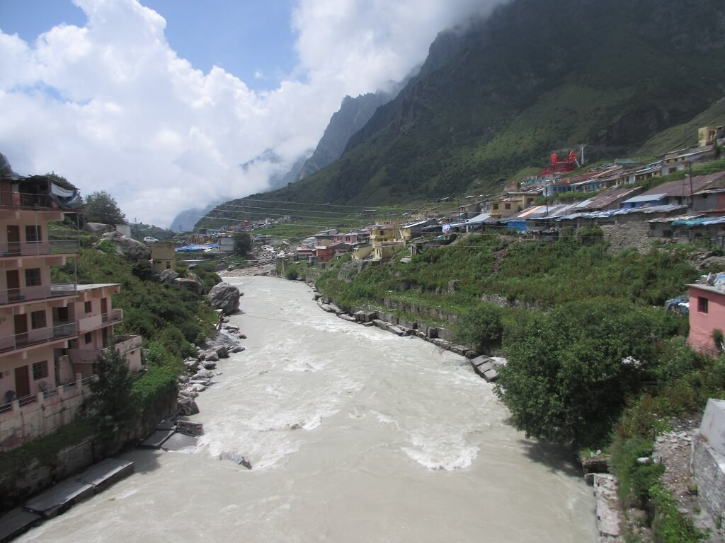 Char Dham Yatra : Alaknanda river flowing close to the Badrinath temple of Uttarakhand. It's a fast flowing river. It rushes down from Badrinath valley